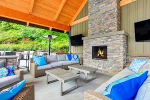 An Outdoor Stone Fireplace Will Light Up Your Summer